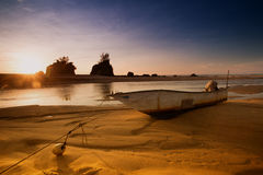 Wooden Boat Sunrise Stock Image