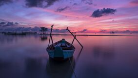 Wooden boat at sunset Stock Image