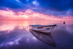 Wooden boat at sunset Stock Photos