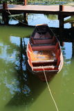 Wooden boat tied at the dock Stock Photography