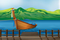 A wooden boat tied at the seaport. Illustration of a wooden boat tied at the seaport Stock Photos