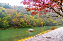 Wooden boat for tourist enjoy beautiful scene Autumn leaves in J. Wooden boat for tourist enjoy beautiful scene Autumn leaves in Kyoto, Japan Royalty Free Stock Photography