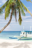 Wooden boat on tropical beach Stock Image