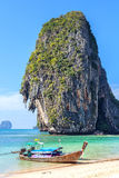Wooden boat on tropical beach Railay in Thailand Stock Photo