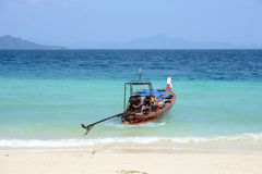 Wooden boat on the tropical beach Stock Photo