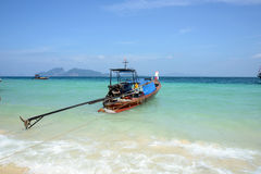 Wooden boat on the tropical beach Stock Photos