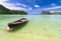 Wooden boat on a tropical beach. Stock Image