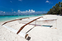 Wooden boat on tropical beach with white sand Royalty Free Stock Photography