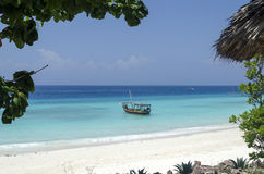 Wooden boat on turquoise water in Zanzibar Royalty Free Stock Photo