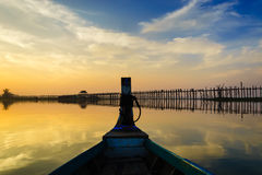 Wooden boat in Ubein Bridge at sunrise, Mandalay, Myanmar Royalty Free Stock Photography