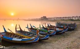 Wooden boat in Ubein Bridge at sunrise, Mandalay, Myanmar Stock Image