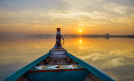 Wooden boat in Ubein Bridge at sunrise, Mandalay, Myanmar Stock Images
