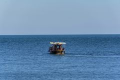 Wooden boat used to transport tourists in the Blach Sea. A group of tourists on a whale watching trip in the Black Sea near Tomis harbour, Constanta Romania Royalty Free Stock Images