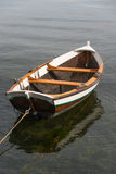 Wooden boat on water Royalty Free Stock Image