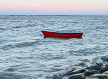 Wooden boat in the water Stock Image