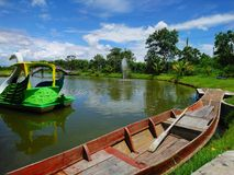 Wooden boat and water bike in the park Royalty Free Stock Photo