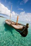 Wooden boat on the water Stock Images