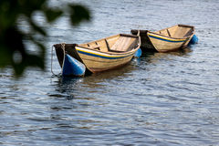 Wooden boat on water Stock Image