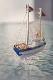 Wooden boat with wedding rings Royalty Free Stock Photography
