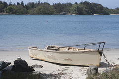 Wooden boat. On the white sandy beach stock image