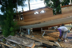 Wooden boat. Workers were making a wooden boat at a village in Jepara, Central Java, Indonesia royalty free stock photo