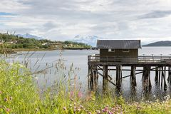 Wooden boathouse on a fjord on Lofoten, Nordland, Norway royalty free stock photos