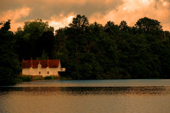 Wooden boathouse on a tranquil lake, Virginia Water. royalty free stock photos