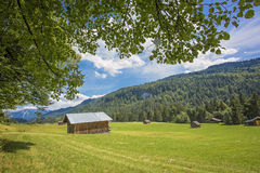 Wooden boathouse on the mountain lake in Bavarian Alps royalty free stock photo