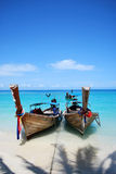 Wooden boats. Thai longtail boats parked at sandy beach, over the crystal clear Andaman sea water, bamboo island Royalty Free Stock Photography