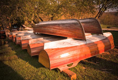 Wooden boats. Drying on the ground bottom-up in pile Stock Image