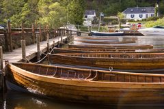 Wooden Boats. Rowing boats lined up at Balmaha, Loch Lomond, Scotland Stock Photos