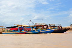 Wooden boats along the bank of Tonle Sap lake Stock Photography