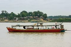 Wooden boats anchored on Ayeyarwady river near Mandalay, Myanmar. Ayeyarwady river is the largest river in Myanmar Stock Photo