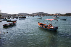 Wooden boats anchored in connection channel with the sea Royalty Free Stock Images