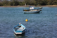 Wooden boats anchored in connection channel with the sea Stock Photography
