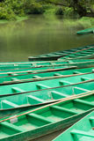 Wooden boats anchored on river (1). Green wooden boats anchored on river (1 Stock Photography