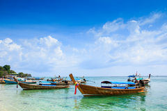 Wooden boats on the beach. With the blue sky and sea Royalty Free Stock Image