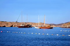 Wooden boats in a calm blue sea Royalty Free Stock Image