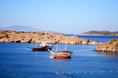 Wooden boats in a calm blue sea Royalty Free Stock Photography