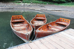 Wooden boats chained to the dock Royalty Free Stock Image
