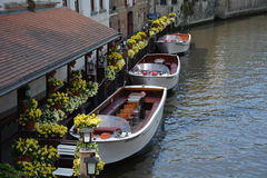 Wooden boats in the channel. Boat trip in the channel of Brugge, Belgium Royalty Free Stock Photography