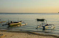 Wooden boats docking on Sanur beach in Bali, Indonesia Stock Images