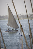 Wooden boats felucca at the Nile River in Aswan, Egypt, North Af Stock Images