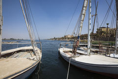 Wooden boats felucca at the Nile River in Aswan, Egypt, North Af. Rica Stock Photography