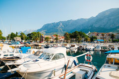 Wooden boats and fishing boats in Makarska. Croatia Stock Photo