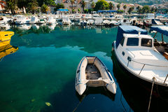Wooden boats and fishing boats in Makarska. Croatia Stock Photos