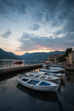Wooden boats float moored in Bay of Kotor Royalty Free Stock Photography