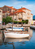 Wooden boats float moored in Kotor Bay Stock Photography