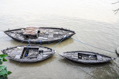 Wooden boats on a ganges river in Varanasi, India. stock images
