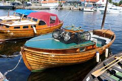 Wooden boats in harbor Kristiansand Norway. Picture taken in summertime stock image